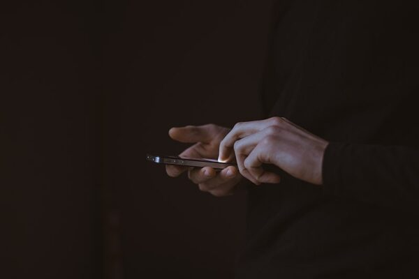 Gilles Lambert - man on a smartphone - Unsplash