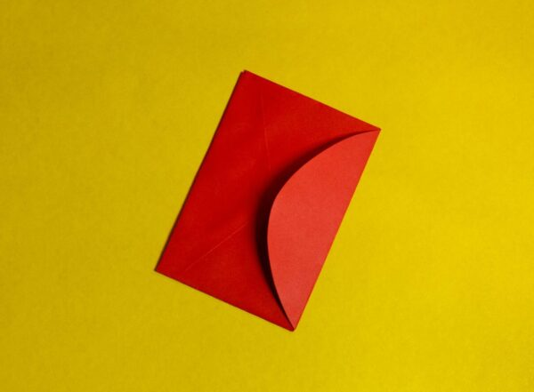 Lucas George Wendt - orange paper on yellow surface photo – Free Paper Image on Unsplash